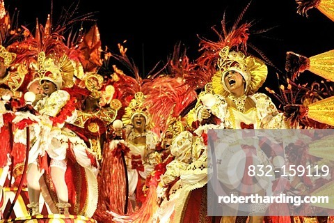 Samba dancers on an allegorical float of the Beija-Flor de Nikopol samba school at the Carnaval in Rio de Janeiro 2010, Brazil, South America