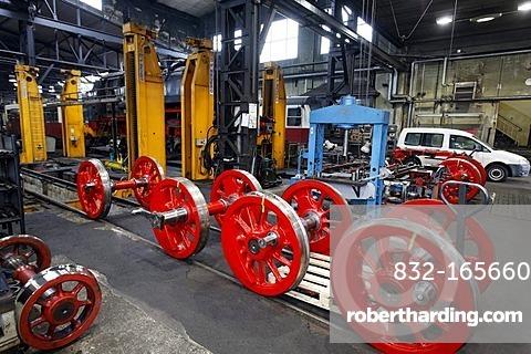 Wheel axles of a historic steam locomotive in the workshop building, depot of the HSB, Harzer Schmalspurbahnen narrow-gauge railway, Wernigerode, Harz, Saxony-Anhalt, Germany, Europe
