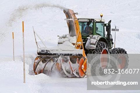 Tractor with snow thrower removing snow, Obertauern, Hohe Tauern region, Salzburg, Austria, Europe