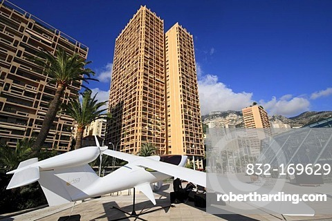Small aircraft of the brand Visa Airplanes in front of the Grimaldi Forum, skyscrapers Columbia Palace and Houston Palace, Principality of Monaco, Cote d'Azur, Europe