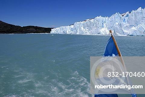 Perito Moreno Glacier, with an Argentinian flag, Patagonia, Argentina, South America