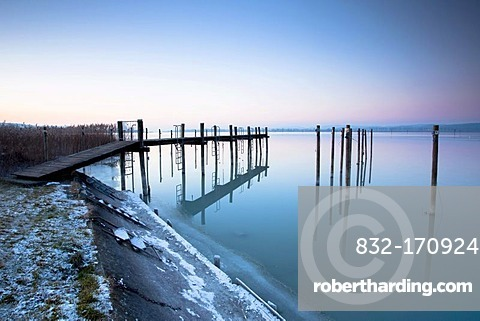 Jetty in the evening light on wintery Lake Constance near Triboltingen in Switzerland, Europe