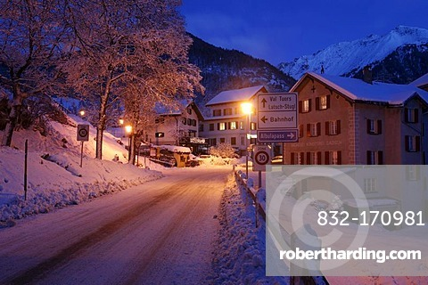 Evening in the snowy village, pass road at dusk, Berguen, Grisons, Switzerland, Europe