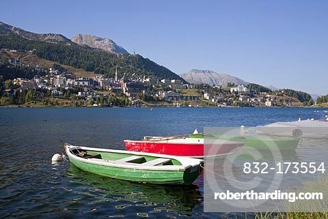 View of St. Moritz, townscape, fishing boats, Lake St. Moritz, Upper Engadine, Engadine, Grisons, Switzerland, Europe
