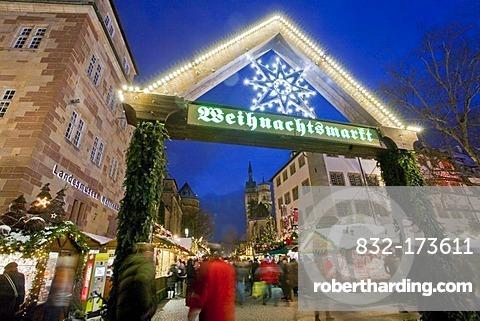 Christmas market in the evening, market stalls, people, snow, winter, Stuttgart, Baden-Wuerttemberg, Germany, Europe