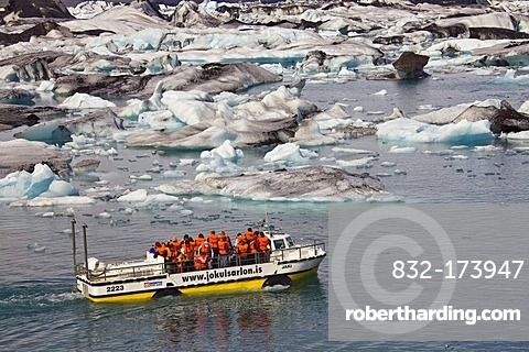 Amphibious vehicle with tourists on board on the Joekulsarlon glacial lake, Joekulsarlon, Vatnajoekull, Iceland, Europe