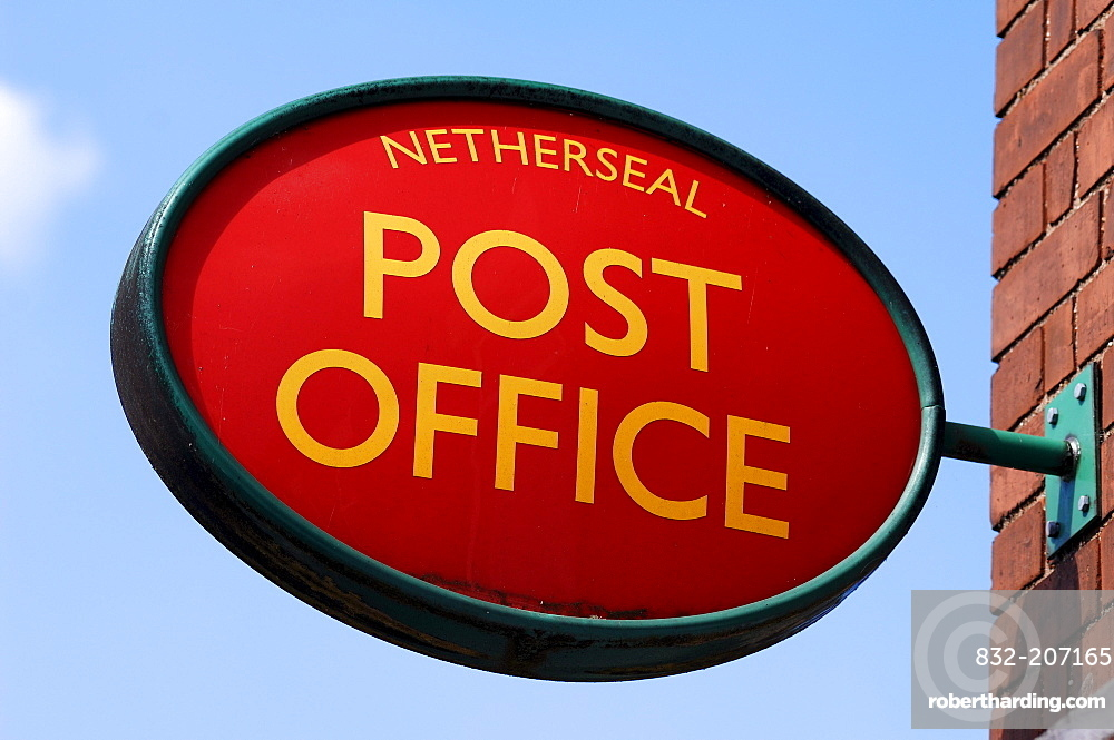 Post office sign at a grocery store against a blue sky, Netherseal, South Derbyshire, England, UK, Europe