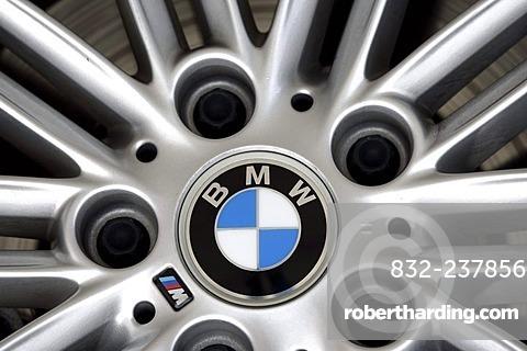 Aluminium wheel rim of a BMW 3 with company logo