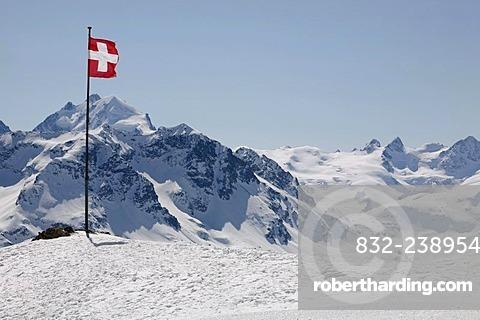 Swiss national flag on the plateau Trais Fluors, St. Moritz, Oberengadin, Graubuenden, Switzerland