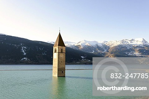 Lake Resia, Lago di Resia, with the tower of the old church of Graun submerged in the lake, Vinschgau, Val Venosta, Alto Adige, Italy, Europe