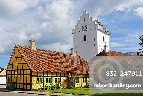 Tower of the Parish Church of St. Maria above a half-timbered house, Saeby, Jutland, Denmark, Europe