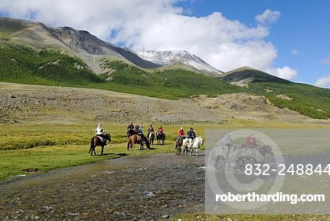 Group of tourists with horses riding through a river, Saljugem, Sailughem, Saylyugem Mountains, Tschuja Steppe, Altai Republic, Siberia, Russia, Asia