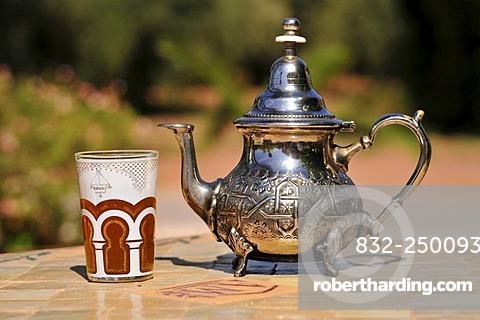 Silver teapot and tea glass with peppermint tea, Menara Gardens, Marrakech, Morocco, Africa