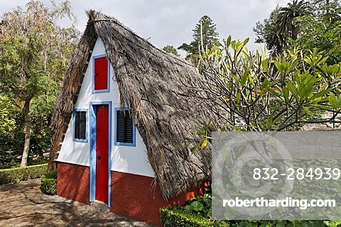 A typical house in the Santana style with a straw covered roof in the botanical garden, Funchal, Madeira, Portugal