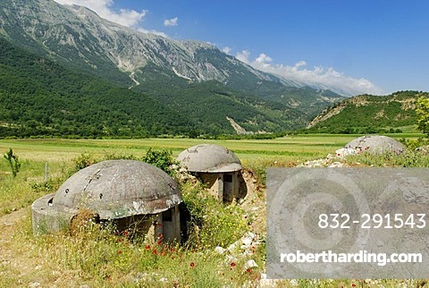 Typical Albanian bunkers in the Vjoses valley, Aoos, with the Nemercke Mountain Range, Albania, Europe