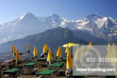 View at Mt Eiger, Monch and Jungfrau from the terrasse of the restaurant Schynigge Platte Berner Oberland Switzerland