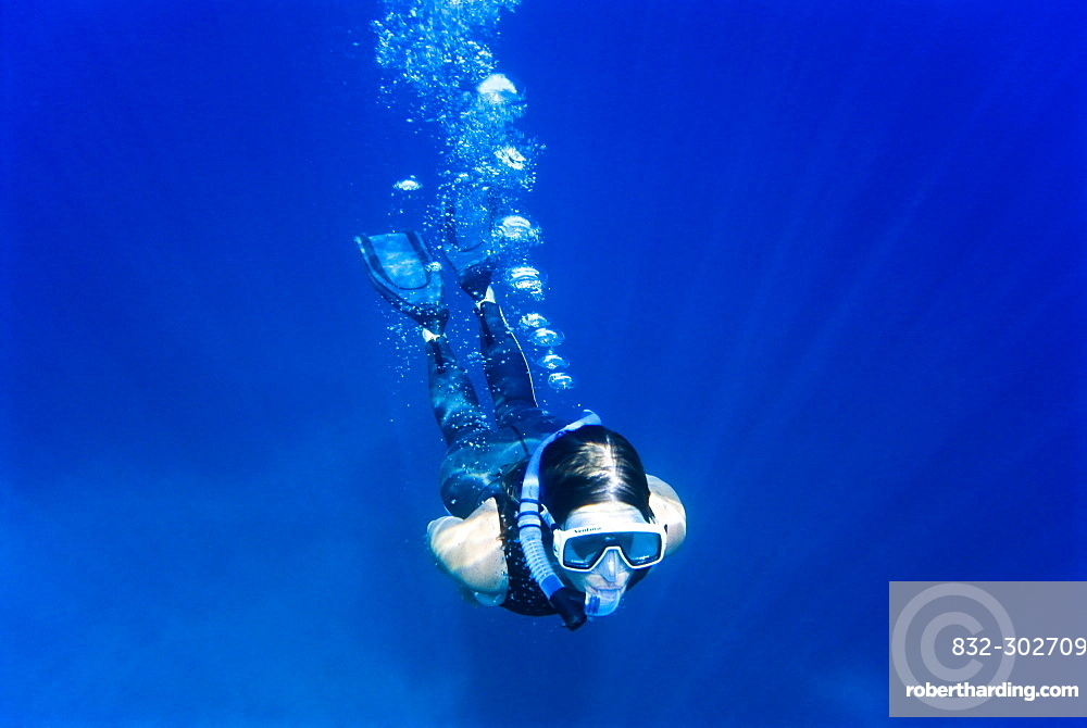 Woman snorkeling, Crete, Greece