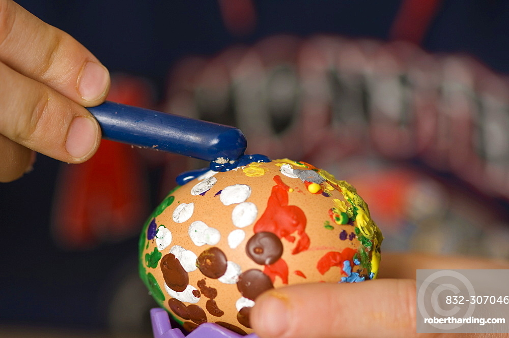 Child painting an Easter egg