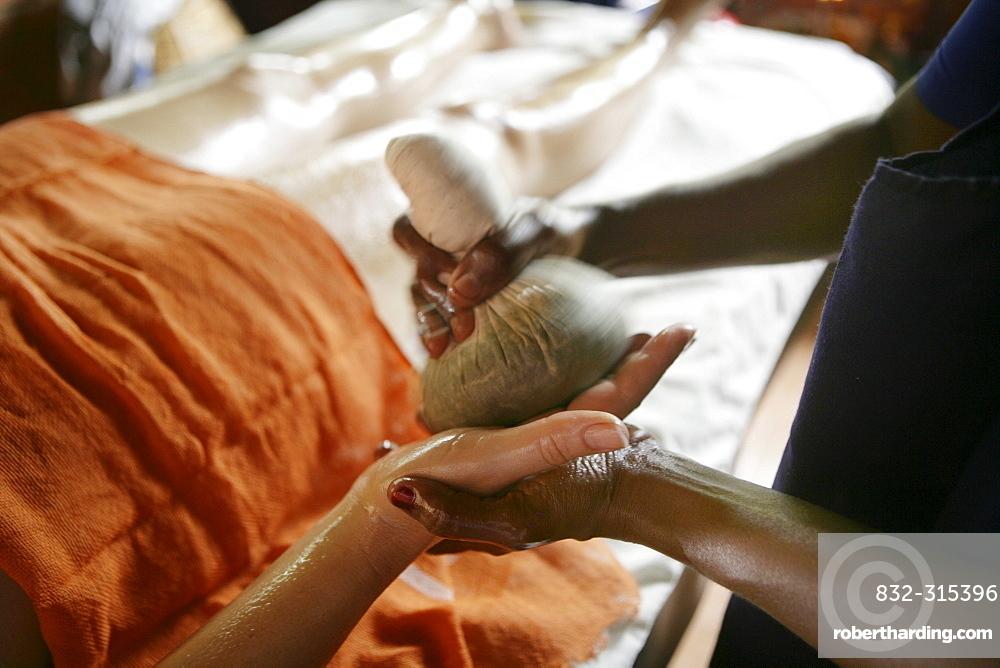 Hand massage using herb pouches, Somatheeram Ayurveda Resort, traditional Ayurvedic medicine spa resort in Trivandrum, Kerala, India, Asia