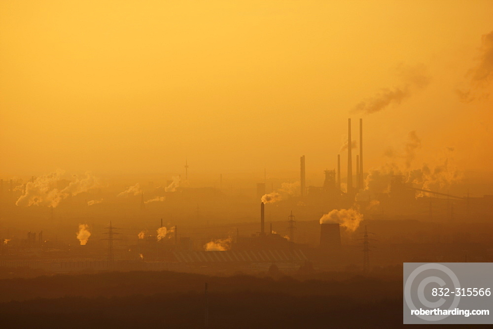 Hazy view of the Thyssen-Krupp steelworks at Hamborn, Schwelgern at sunset, near Duisburg, North Rhine-Westphalia, Germany, Europe