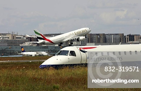 DEU, Federal Republic of Germany, Frankfurt: Frankfurt-Main airport, Fraport. Airbus A330 plane, Emirates airline, during take off. British Airways plane on the taxiway.