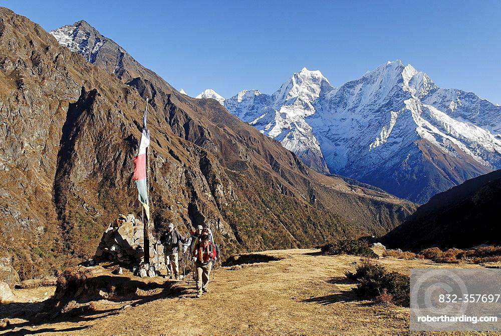 Trekking group at Dudh Koshi valley with Thamserku (6608), Sagarmatha National Park, Khumbu, Nepal