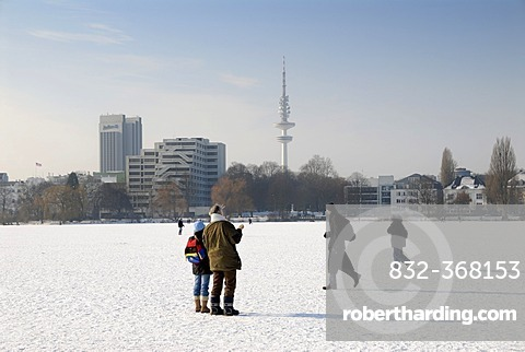 People on the frozen Aussenalster lake in Hamburg, Germany, Europe