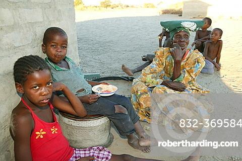 Grandmother with grandchildren, Sehitwa, Botswana, Africa