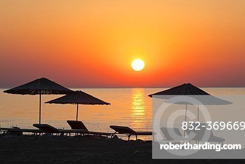 Beach chairs and sunshades on the beach at sunrise, Lycian coast, Lycia, the Aegean, Mediterranean Sea, Turkey, Asia Minor