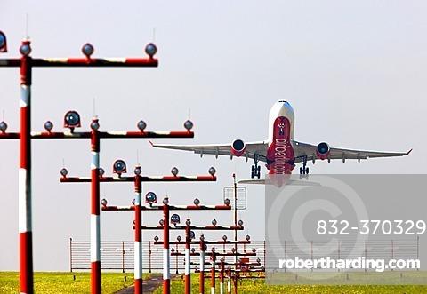 Runway landing lights in front of an Air Berlin Airbus A330 taking off at Duesseldorf International Airport, Duesseldorf, North Rhine-Westphalia, Germany, Europe
