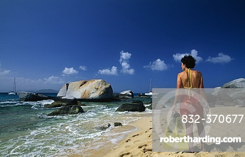 Woman with snorkelling equipment on the beach, The Baths on Virgin Gorda island, British Virgin Islands, Caribbean