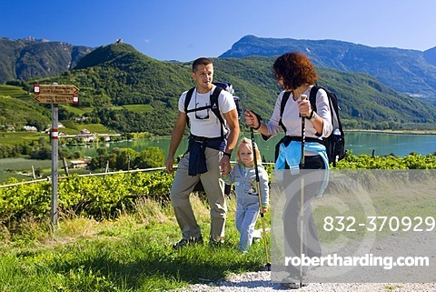 Family hiking on Lake Kaltern, province of Bolzano-Bozen, Italy, Europe