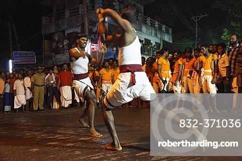 Martial arts demonstration, temple festival in Pulinkudi, Kerala state, India, Asia