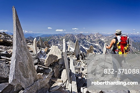 Climber descending from Mt. Hochfeiler, Pfitschtal valley, in the back the Pfitschtal and Wipptal valleys, South Tyrol, Italy, Europe