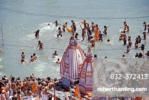 Naked Naga-Sadhus taking a holy bath during the Kumbha or Kumbh Mela in the Ganges River, Har Ki Pauri-Ghat, a famous bathing ghat at Haridwar or Hardwar, Uttarakhand, formerly Uttaranchal, North India, India, Asia