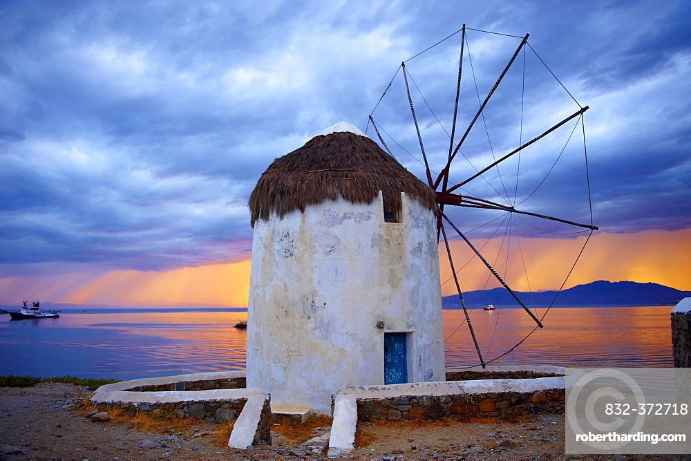 Sunset over the traditional Greek windmills of Mykonos Chora, Cyclades Islands, Greece, Europe