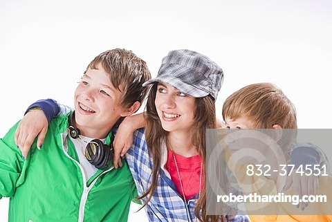 Three friends, one girl and two boys, arm in arm