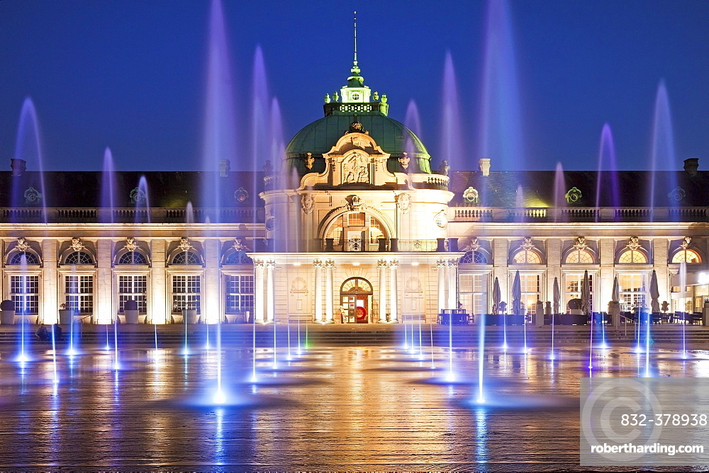 Illuminated imperial palace with water fountains in the blue hour, spa garden, Bad Oeynhausen, Ostwestfalen-Lippe, North Rhine-Westphalia, Germany, Europe
