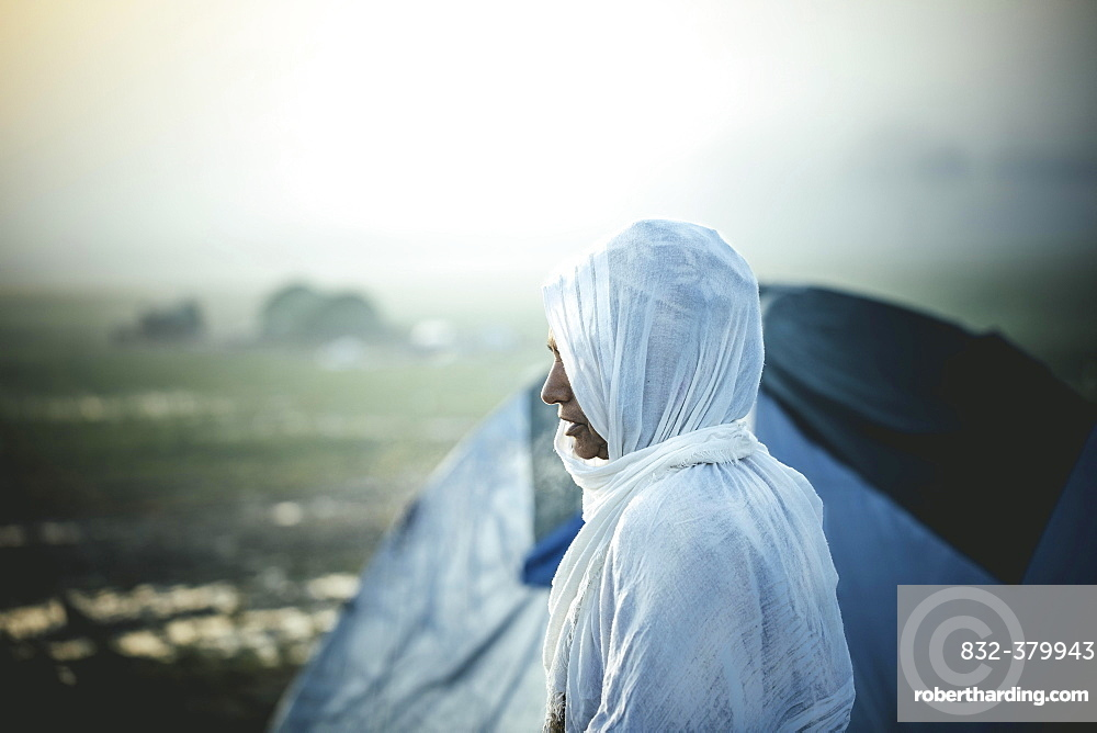 Woman in front of tent, refugee camp Idomeni on the Greek-Macedonian border, Greece, Europe
