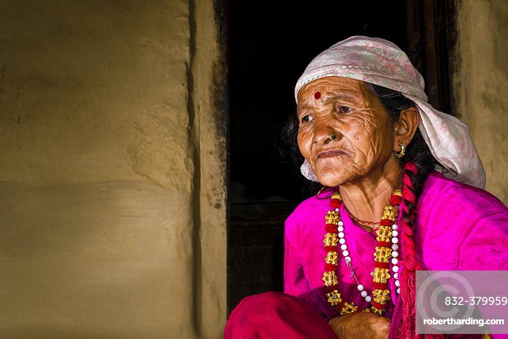 Portrait, old, wrinkled native woman, wearing pink shirt, Ghandruk, Kaski District, Nepal, Asia