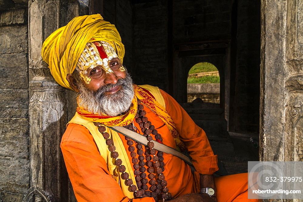 Portait of a Sadhu, holy man, sitting at a shrine at Pashupatinath temple, Kathmandu, Kathmandu District, Nepal, Asia