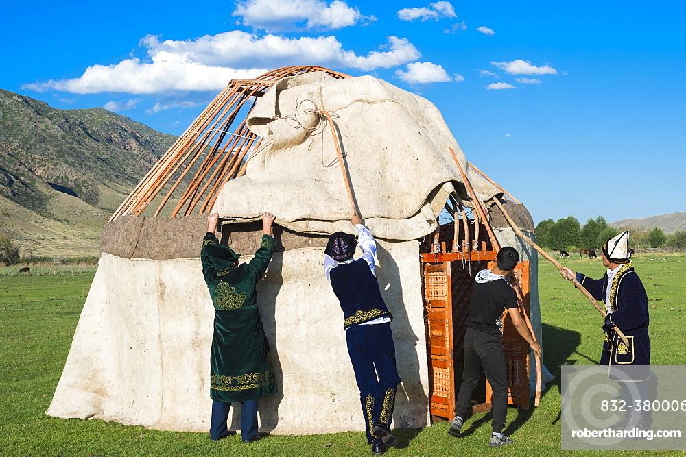 Kazakh men putting up a yurt, Sati village, Tien Shan Mountains, Kazakhstan, Asia