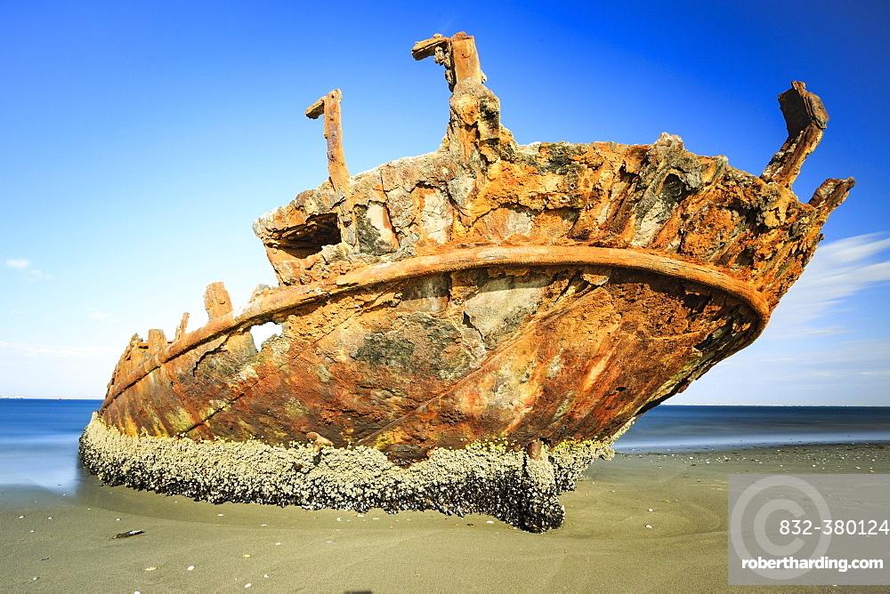 Rusty shipwreck on the beach, Pelican Point, Skeleton Coast, Erongo region, Namibia, Africa
