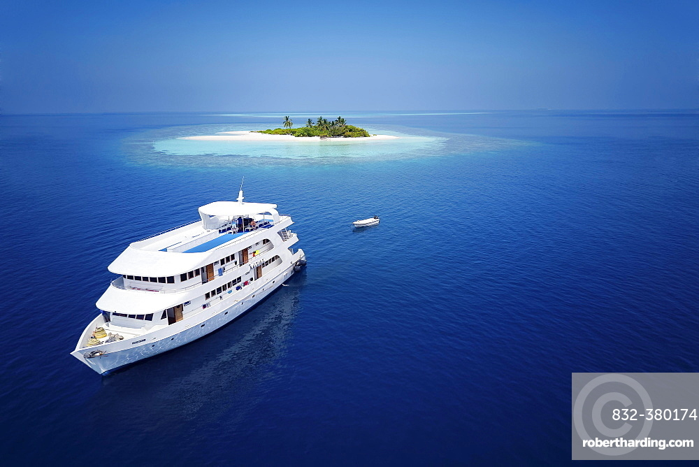 Diving safari ship MS Keana off an uninhabited palm island, Ari Atoll, Indian Ocean, Maldives, Asia