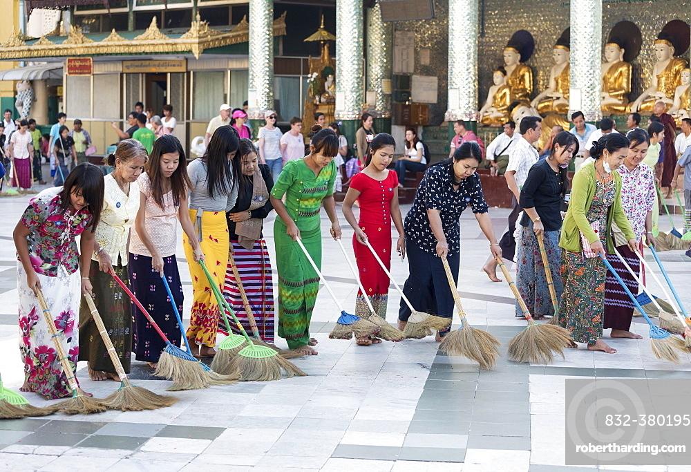 Burmese women sweeping the floor of the Shwedagon Pagoda, Yangon, Rangoon, Myanmar, Asia