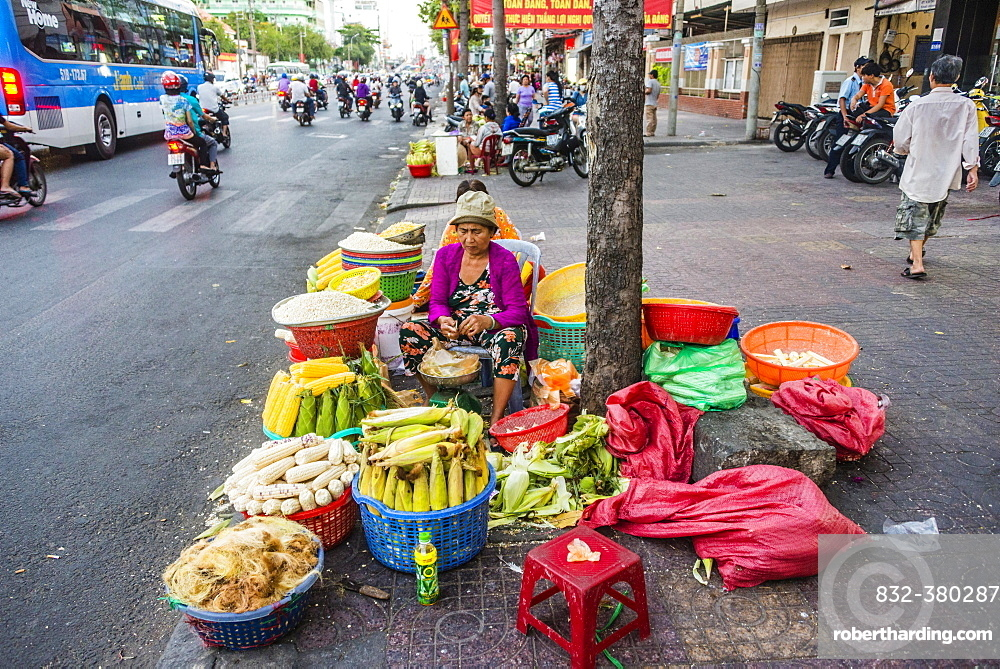 Woman selling vegetables by the roadside, Ho Chi Minh City, Ho Chi Minh City, Vietnam, Asia