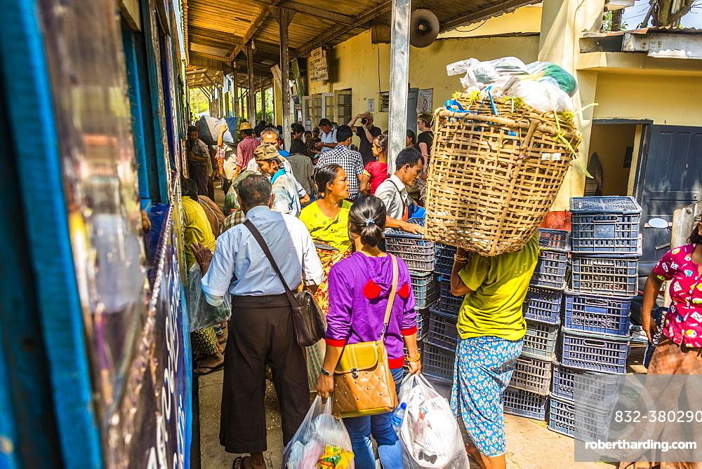 Locals boarding train on platform, Yangon Circular Railway, Yangon, Myanmar, Asia