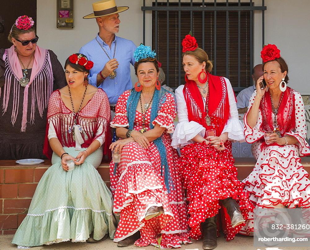 Women wearing colourful gypsy dresses, Pentecost pilgrimage of El Rocio, Huelva province, Andalusia, Spain, Europe