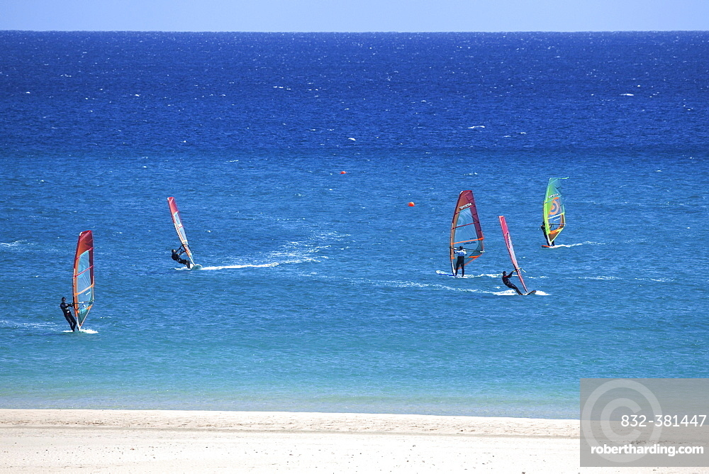 Windsurfers in the turquoise waters off the Playa Risco del Paso beach, Playa de Sotavento, Jandia, Fuerteventura, Canary Islands, Spain, Europe