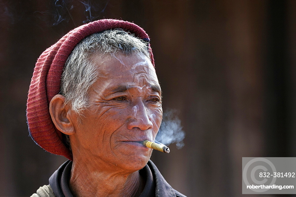 Man of the Akha ethnic group, with cigar, portrait, near Kyaing Tong, Myanmar, Asia